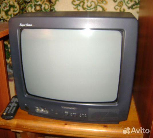 Щёлкните для просмотра следующей фотографии.  Маленький телевизор Daewoo 14Q2M.